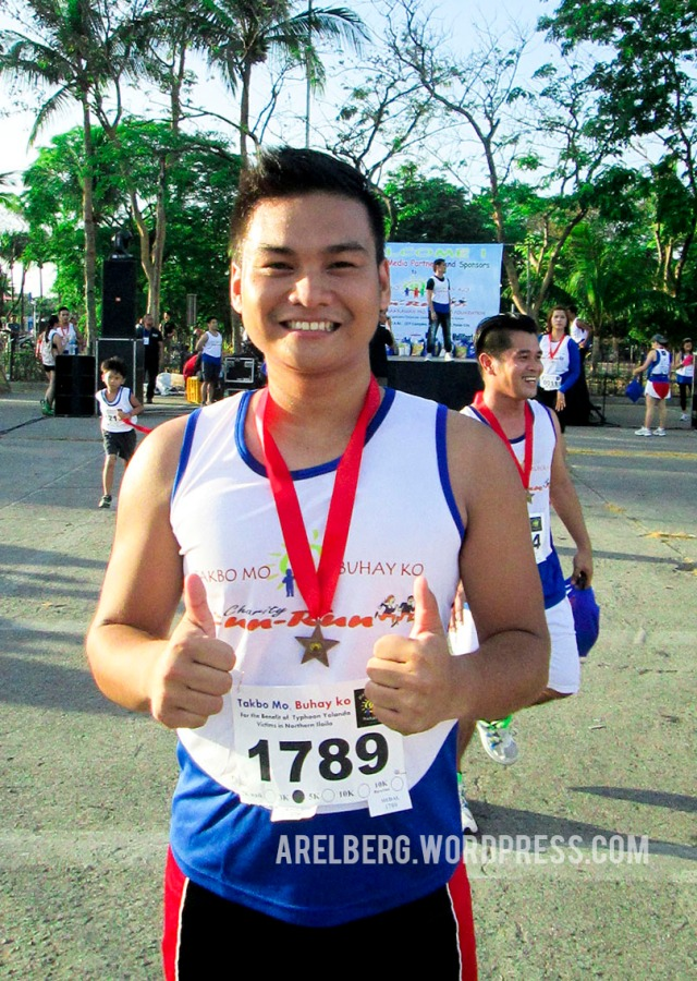 Me after receiving my medal for completing the 3K run.