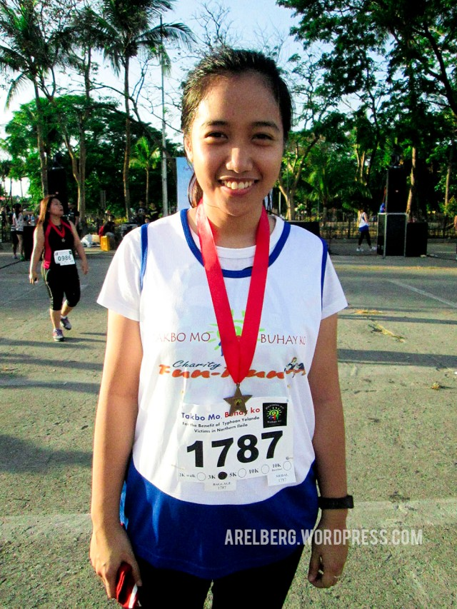 My honey after receiving her medal for completing the 3K run.